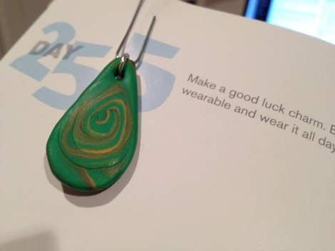 """I made this """"writing amulet"""" this evening. It's just a bit of clay, rolled and shaped and baked and attached to a paper clip. Nothing fancy. But it's charged with my hopes for great stories. I'll hang it on my journal pages while I write."""