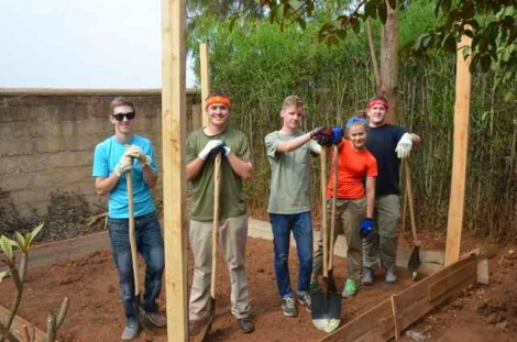 My son is at far left, preparing to mix and pour concrete for a gazebo in Rwanda.